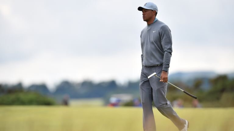 Tiger woods looking thoughtful